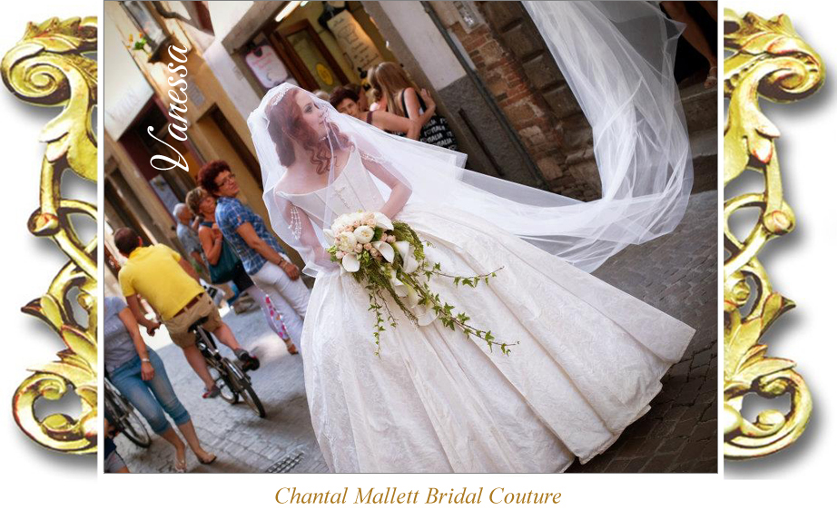 Couture ivory silk brocade corseted wedding gownwith balgown skirt & train by Chantal Mallett