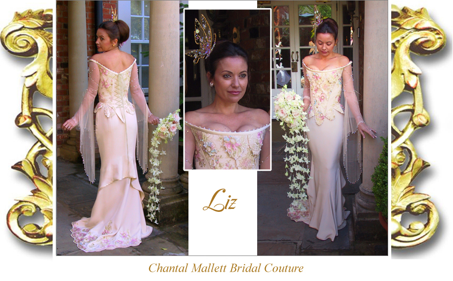 Bespoke cream silk crepe corseted wedding gown with hand painted lace & unusual double fishtail by Chantal Mallett.