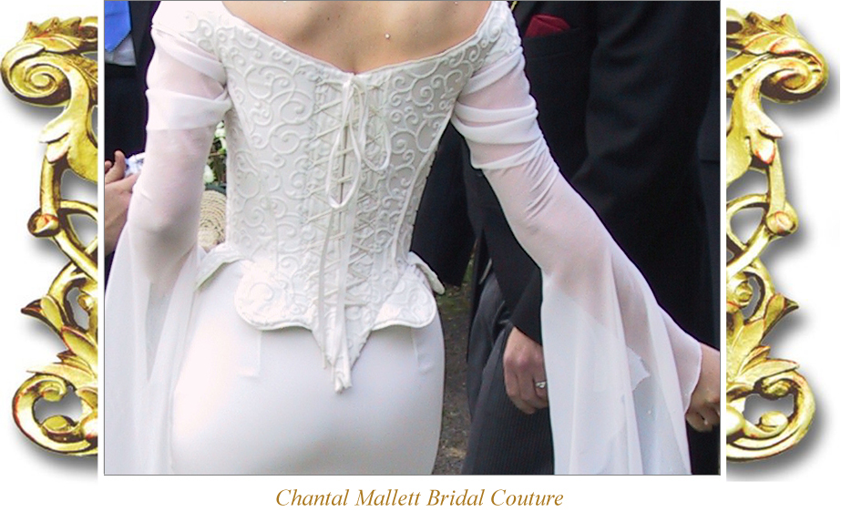 Couture ivory silk devore & crepe corseted wedding gown with fishtail & medieval georgette sleeves by Chantal Mallett.