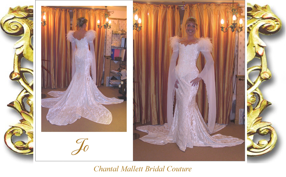 Coutureivory velvet corseted wedding gown with mermaid skirt, feathers & georgette medieval sleeves by Chantal Mallett.