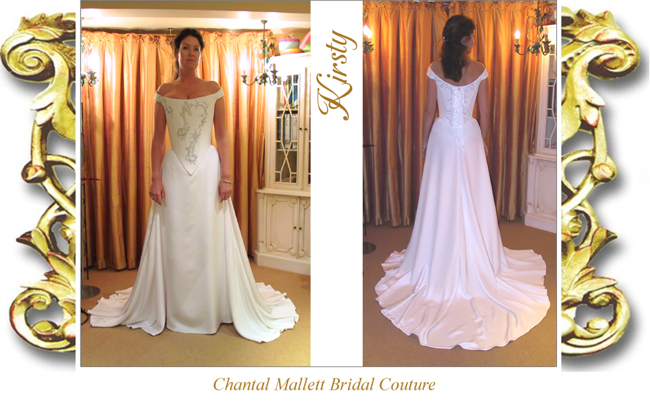 Bespoke white silk crepe corseted wedding dress with a-line skirt & train, trimmed with silver lace by Chantal Mallett.